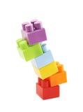 Stapel von mehrfachen Spielzeugziegelsteinen Stockbild