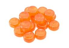 Stapel von orange Bonbons Lizenzfreie Stockbilder
