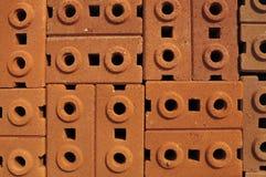 Stapel Ziegelsteine des roten Lehms Stockbild