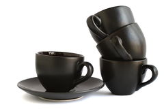 Stapel zwarte koffiekoppen Stock Foto