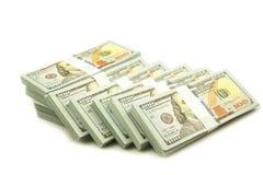 Stapelbundels van 100 Amerikaanse dollarsbankbiljetten stock foto's