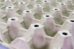 Stapelpappe, die für Eier, Stapel Papier, Eierablage, Beschaffenheitshintergrund verpackt stockbild