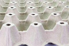 Stapelpappe, die für Eier, Stapel Papier, Eierablage, Beschaffenheitshintergrund verpackt lizenzfreie stockfotos