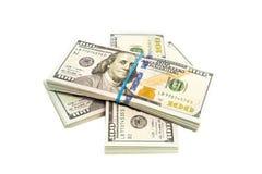 Stapels geïsoleerde dollars royalty-vrije stock foto