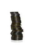 Stapels muntstukken die op witte achtergrond worden geïsoleerdt royalty-vrije stock foto