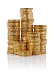 Stapels van gouden muntstukken Stock Afbeeldingen