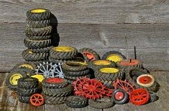 Stapels van Toy Tractor Tires en Randen Stock Foto's