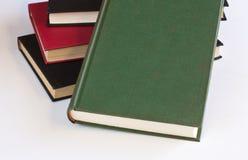 Staplade böcker med vit royaltyfria foton