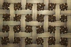 Staplade fyrkanter för kaffebönor Arkivfoton