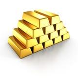 Staplade guld- stänger på vit bakgrund Arkivfoton