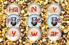 Staplade nedersta och tenn- cans skriver lyckligt nytt år Arkivfoto