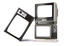 Staplade retro televisioner royaltyfri bild