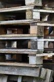 Staplade träpaletter Fotografering för Bildbyråer
