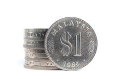 Staplat av gamla Malaysia mynt på vit bakgrund Royaltyfria Bilder