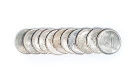 Staplat av gamla Malaysia mynt på vit bakgrund Arkivbilder