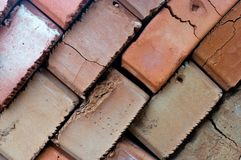 Staplat i diagonala vägtegelstenar arkivbild