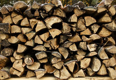 Staple of firewood frost-covered. A frost-covered staple of firewood.Ready to be used for a romantic night in a lodge Royalty Free Stock Photography