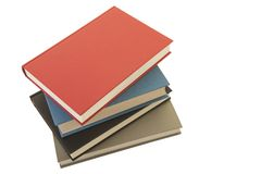 Staple of books seen from an high angle view isolated on a white background Royalty Free Stock Photo