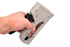 Staple gun. In hand on a white background Stock Photos
