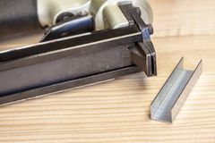 Staple gun. On wood table Royalty Free Stock Photo