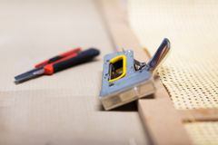 Staple gun and cutter knife with furniture item Stock Photo