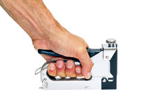 Staple gun  in the man's hand. On a white background Royalty Free Stock Photos