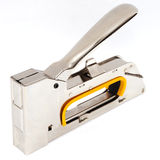 Staple gun. Metal staple gun on white background Stock Images