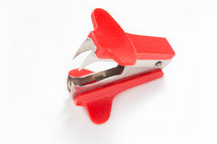 Staple remover. Red staple remover on white background Royalty Free Stock Images