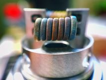 Staple staggered fused clapton coil color background Stock Photo