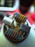 Staple staggered fused clapton coil color background Stock Images