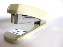 Stapler. A brown stapler on the white background Stock Photo