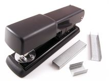 Stapler. A black stapler with staples Royalty Free Stock Images