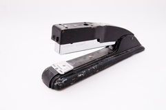 Stapler 2. An old beaten up stapler sits partially open on an angle Stock Images