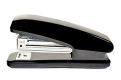Stapler. With black plastic overlays on white background royalty free stock image