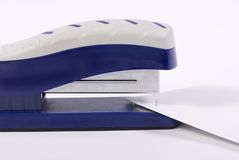 Stapler. A small blue stapler with a couple papers that have just been stapled Stock Photos