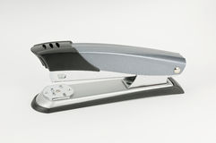 Stapler. Silver stapler on white background Stock Photos