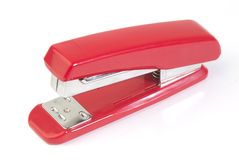Stapler. Red swing-line stapler isolated with white background royalty free stock photography