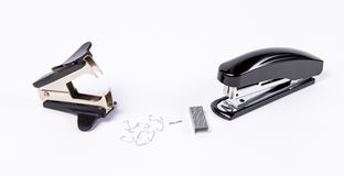 Stapler and antistapler with staples. On white background Royalty Free Stock Photo