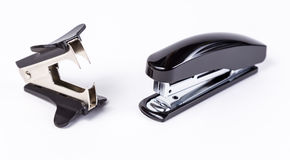 Stapler and antistapler on white Royalty Free Stock Photo