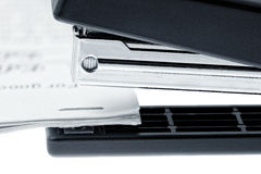 Stapler attach a documents. Isolated on a white. Royalty Free Stock Photo