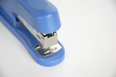 The stapler is blue. Stapler local details of blue white background Stock Photography