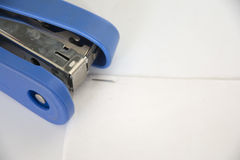 The stapler is blue. Stapler local details of blue white background Stock Images