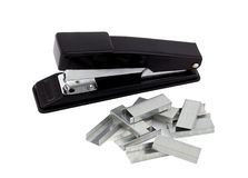 Stapler and clip. Black stapler and clip, isolated on white background royalty free stock photo