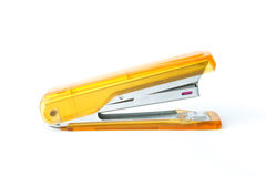 Stapler. Close up orange stapler isolation on white background Royalty Free Stock Images
