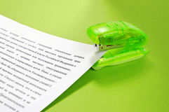 Stapler and documents. On a green background stock image