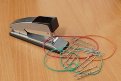 Stapler, elastic bands and clips. Royalty Free Stock Photo