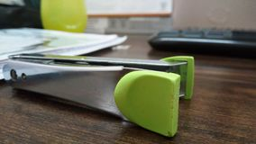Stapler. Green Stapler with Blur background stock photography