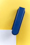 Stapler holds sheets of paper Royalty Free Stock Images
