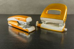 Stapler and hole punch. Office and school attributes stock photos