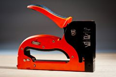 Stapler household new orange, reliable royalty free stock image